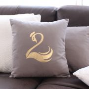 Magnifique coussin taupe Cygne or