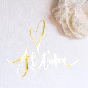 Cadre Je t'aime coeur blanc et or