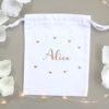 Pochon blanc petits cœurs à personnaliser avec un prénom